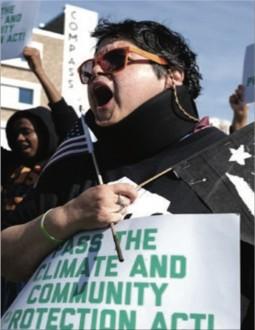 Luz Velez at a Protest Rally